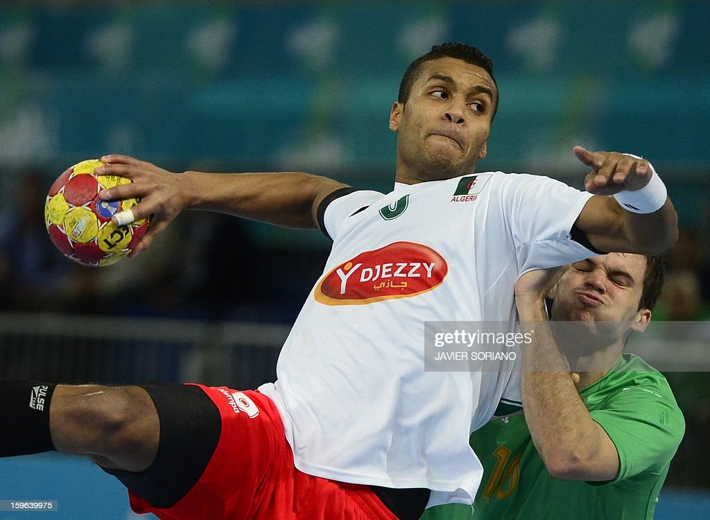 Algeria's left back Messaoud Berkous (L) shoots past Australia's centre back Caleb Gahan (R) during the 23rd Men's Handball World Championships preliminary round Group D match Australia vs Algeria at the Caja Magica in Madrid on January 17, 2013. AFP PHOTO/ JAVIER SORIANO