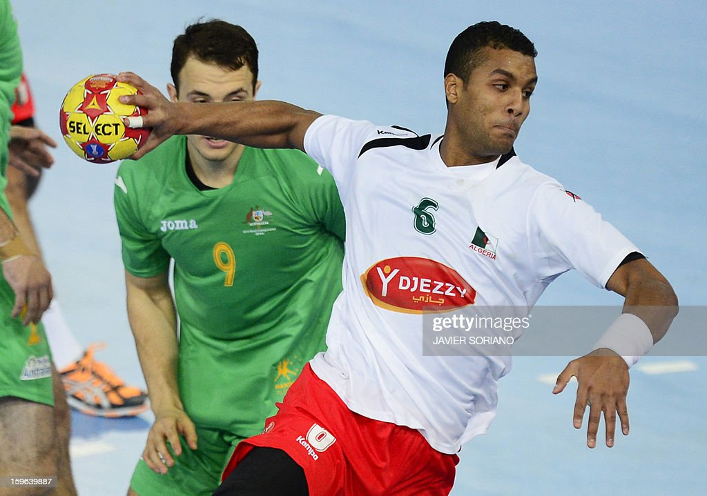 Algeria's left back Messaoud Berkous (R) shoots past Australia's right wing Martin Najdovski (L) during the 23rd Men's Handball World Championships preliminary round Group D match Australia vs Algeria at the Caja Magica in Madrid on January 17, 2013. AFP PHOTO/ JAVIER SORIANO