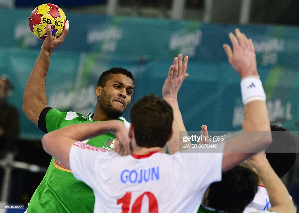 Algeria's left back Messaoud Berkous (L) tries to shoot during the 23rd Men's Handball World Championships preliminary round Group D match Algeria vs Croatia at the Caja Magica in Madrid on January 14, 2013.
