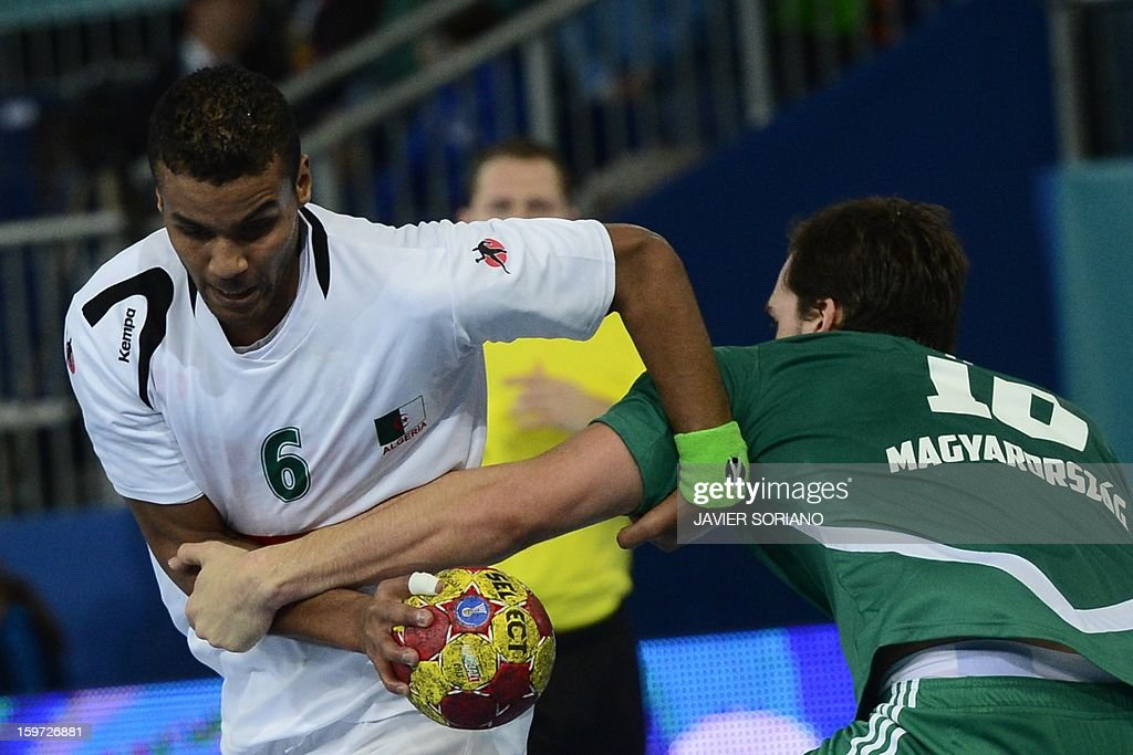 Algeria's left back Messaoud Berkous (L) vies with Hungary's right wing Gergely Harsanyi during the 23rd Men's Handball World Championships preliminary round Group D match Hungary vs Algeria at the Caja Magica in Madrid on January 19, 2013.