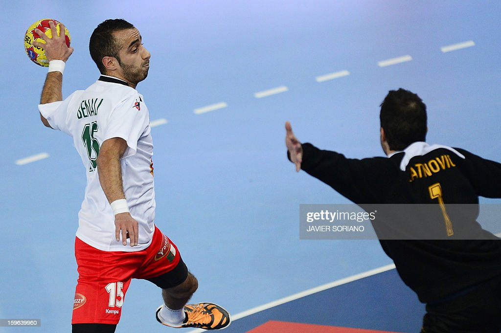 Algeria's left wing Riad Chehbour (L) shoots in front of Australia's goalkeeper Ognjen Latinovic (R) during the 23rd Men's Handball World Championships preliminary round Group D match Australia vs Algeria at the Caja Magica in Madrid on January 17, 2013.