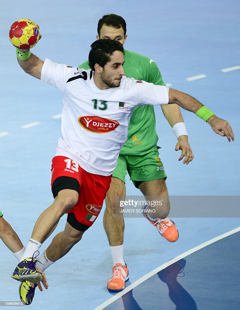 Algeria's left wing Riad Chehbour (L) shoots past Australia's right wing Martin Najdovski (R) during the 23rd Men's Handball World Championships preliminary round Group D match Australia vs Algeria at the Caja Magica in Madrid on January 17, 2013.