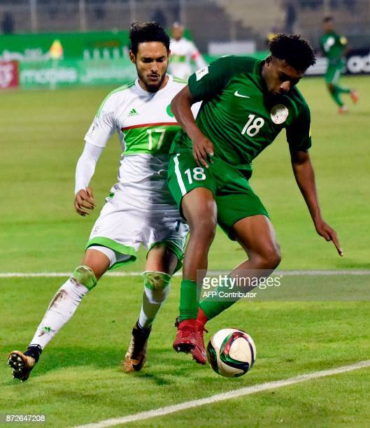 Algeria's Liassine Cadamuro vies for the ball with Nigeria's Alexander Iwobi during the 2018 FIFA World Cup Group B qualifying football match between...