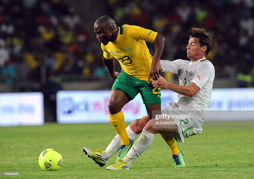 Algeria's Mehdi Mostefa-Sbaa (R) vies with South Africa's Tokelo Rantie (L) during a friendly football match between South Africa's Bafana Bafana and Algeria in Soweto on January 12 , 2013, ahead of the 2013 African Cup of Nations that will take place in South Africa from January 19 to February 10.