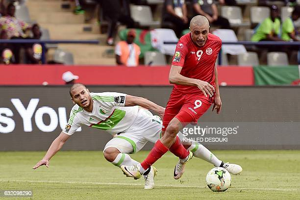 TOPSHOT Algeria's midfielder Adlene Guedioura challenges Tunisia's forward Ahmed Akaichi during the 2017 Africa Cup of Nations group B football match...