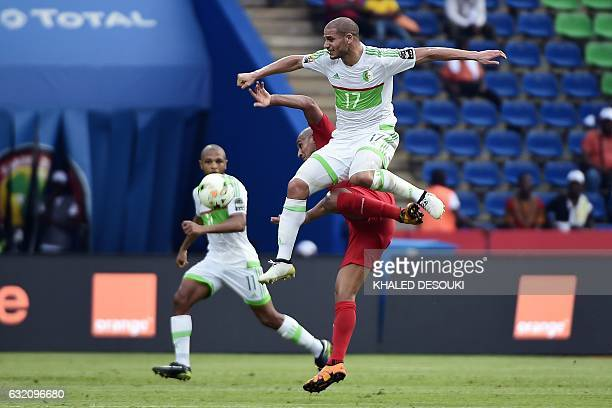 Algeria's midfielder Adlene Guedioura challenges Tunisia's midfielder Wahbi Khazri during the 2017 Africa Cup of Nations group B football match...