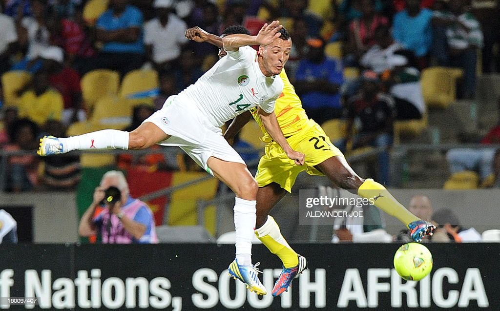 Algeria's midfielder Foued Kadir (L) vies with Togo's defender Dakonam Djene during the 2013 African Cup of Nations football match Algeria vs Togo at Royal Bafokeng stadium in Rustenburg on January 26, 2013. AFP PHOTO / ALEXANDER JOE