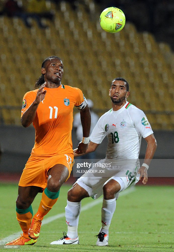 Algeria's midfielder Khaled Lemmouchia (R) vies with Ivory Coast Forward Didier Drogba during a 2013 African Cup of Nations Group D football match in Rustenburg on January 30, 2013 at the Royal Bafokeng stadium. AFP PHOTO / ALEXANDER JOE