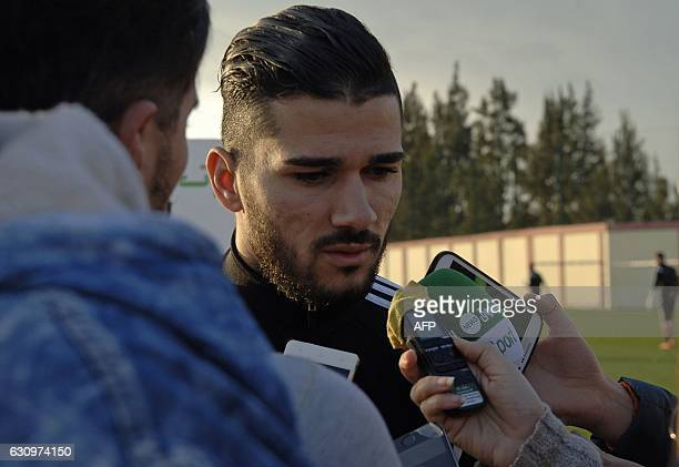 Algeria's midfielder Mehdi Abeid speaks to the press on January 4 at the National Technical Center in Sidi Moussa during preparations for the...