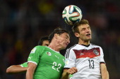 Algeria's midfielder Mehdi Mostefa and Germany's forward Thomas Mueller vie for the ball during a Round of 16 football match between Germany and...