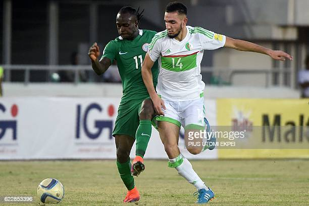 Algeria's midfielder Nabil Bentaleb challenges Nigeria's midfielder Victor Moses during the 2018 FIFA World Cup African zone group B qualifying...