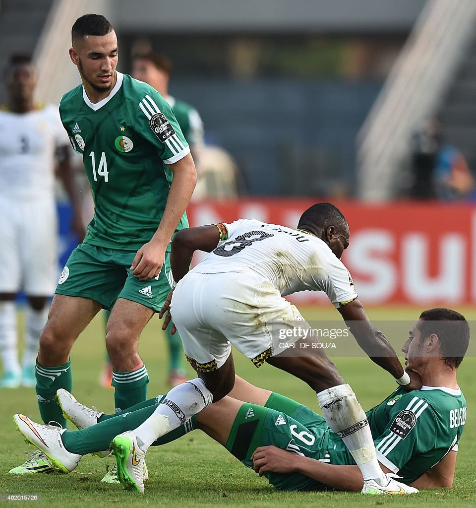 Algeria's midfielder <a gi-track='captionPersonalityLinkClicked' href=/galleries/search?phrase=Nabil+Bentaleb&family=editorial&specificpeople=9549300 ng-click='$event.stopPropagation()'>Nabil Bentaleb</a> (L) reacts as Ghana's midfielder Emmanuel Agyemang Badu (C) scuffles with Algeria's forward <a gi-track='captionPersonalityLinkClicked' href=/galleries/search?phrase=Ishak+Belfodil&family=editorial&specificpeople=6175690 ng-click='$event.stopPropagation()'>Ishak Belfodil</a> (R) during the 2015 African Cup of Nations group C football match between Ghana and Algeria in Mongomo on January 23, 2015.