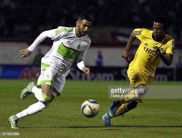 Algeria's midfielder Riyad Mahrez and Ethipian's Dawit Fikadu fight for the ball during the 2017 African Cup of Nations football match between...
