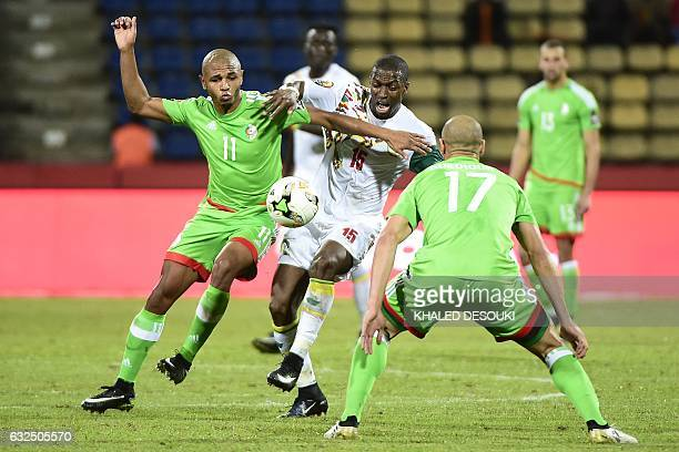 TOPSHOT Algeria's midfielder Yacine Brahimi challenges Senegal's midfielder Papakouli Diop during the 2017 Africa Cup of Nations group B football...