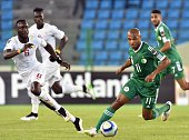 Algeria's midfielder Yacine Brahimi vies with Senegal's defender Lamine Sane during the 2015 African Cup of Nations group C football match between...