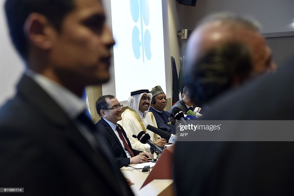 , Algeria's Minister of Energy, Noureddine Boutarfa, the President of the Organization of Petroleum Exporting Countries (OPEC) and Qatar's Energy Minister, Mohammed bin Saleh al-Sada, and OPEC Secretary General Nigeria's Mohammed Barkindo shake hands during a press conference following an informal meeting between OPEC members on September 28, 2016 in the Algerian capital Algiers. / AFP / Ryad Kramdi