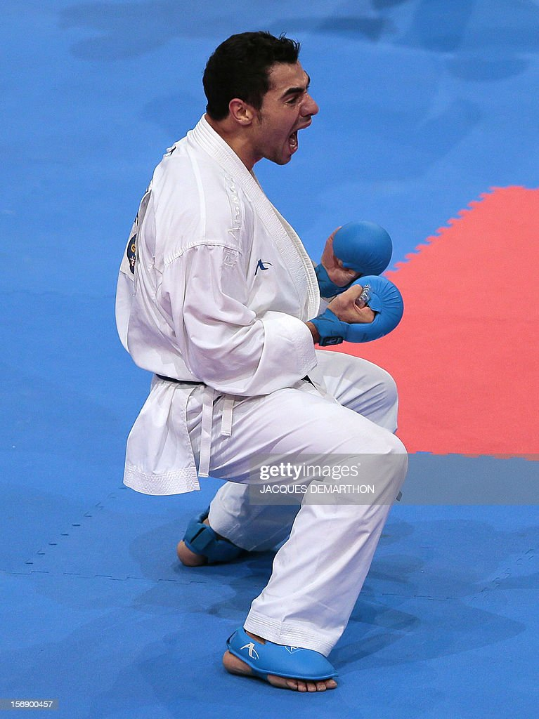 Algeria's Oualid Bouabaoud celebrates after winning his men's bronze medal bout in the under 75 Kg category at the Karate world championships on November 24, 2012 in Paris.