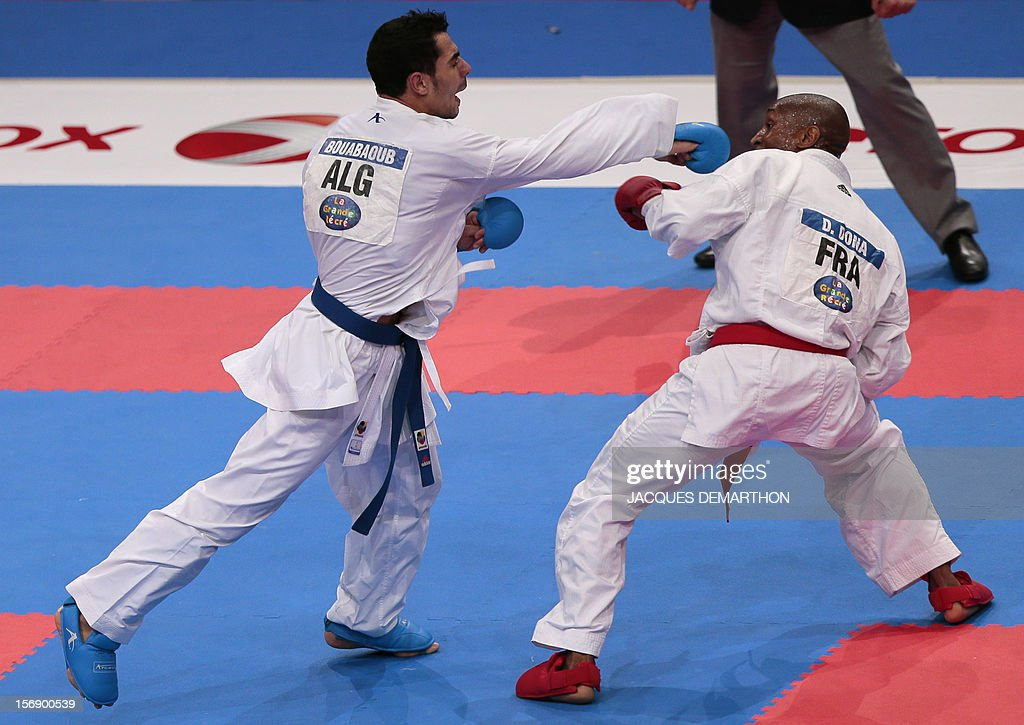 Algeria's Oualid Bouabaoud (L) fights against France's Davy Dona (R) during their men's bronze medal bout in the under 75 Kg category at the Karate world championships on November 24, 2012 in Paris. Bouabaoud won the bout.