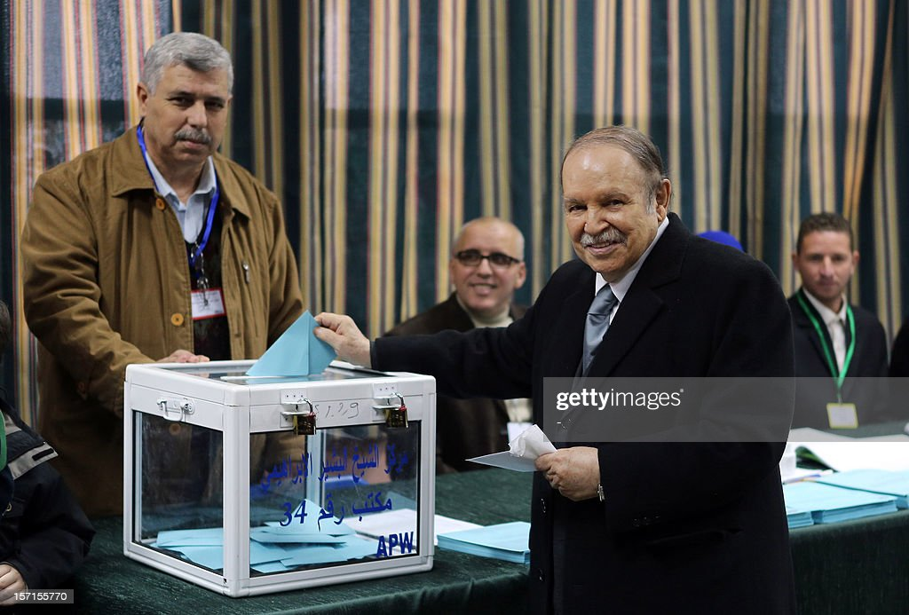 Algeria's president Abdelaziz Bouteflika casts his ballot at a polling station in Algiers during municipal and regional assemblies elections on November 29, 2012. Algeria's ruling party, National Liberation Front (FLN), is eyeing a landslide victory in local elections, with numerous opposition groups warning of fraud in a poll that could struggle to mobilise a disaffected electorate. AFP PHOTO