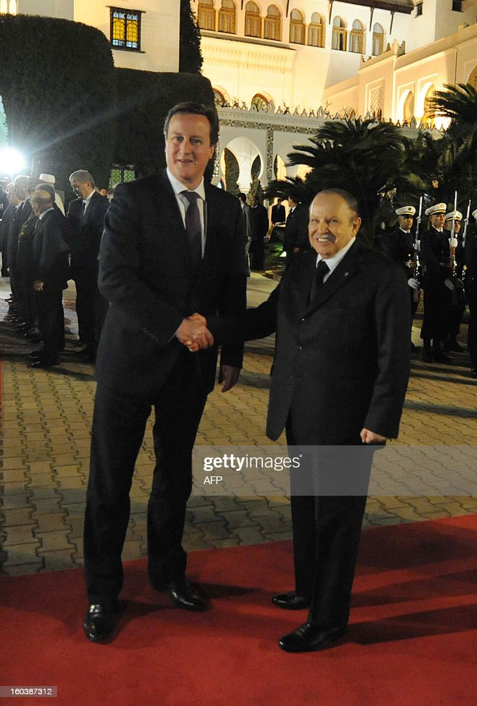 Algeria's President Abdelaziz Bouteflika (R) greets British Prime Minister <a gi-track='captionPersonalityLinkClicked' href=/galleries/search?phrase=David+Cameron+-+Politician&family=editorial&specificpeople=227076 ng-click='$event.stopPropagation()'>David Cameron</a> upon his arival at the People's Palace in the capital Algiers on January 30, 2013. Cameron flew into Algeria in the wake of this month's hostage crisis at a gas plant deep in the Sahara in which several Britons were killed.