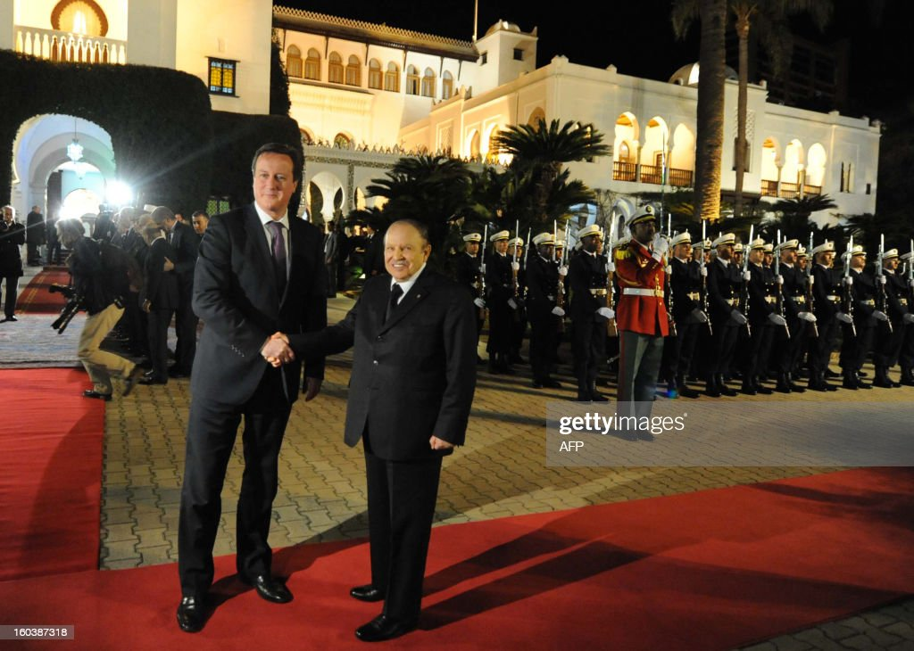 Algeria's President Abdelaziz Bouteflika (R) greets British Prime Minister David Cameron upon his arival at the People's Palace in the capital Algiers on January 30, 2013. Cameron flew into Algeria in the wake of this month's hostage crisis at a gas plant deep in the Sahara in which several Britons were killed.