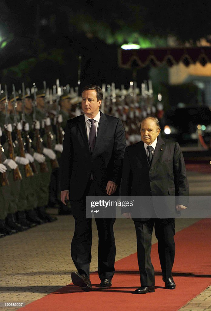 Algeria's President Abdelaziz Bouteflika (R) inspects the honor guard along side British Prime Minister <a gi-track='captionPersonalityLinkClicked' href=/galleries/search?phrase=David+Cameron+-+Politician&family=editorial&specificpeople=227076 ng-click='$event.stopPropagation()'>David Cameron</a> on January 30, 2013, in Algiers. Cameron flew into Algeria in the wake of this month's hostage crisis at a gas plant deep in the Sahara in which several Britons were killed.