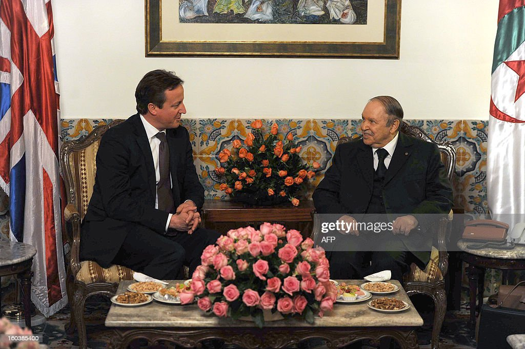 Algeria's President Abdelaziz Bouteflika (R) meets with British Prime Minister <a gi-track='captionPersonalityLinkClicked' href=/galleries/search?phrase=David+Cameron+-+Politician&family=editorial&specificpeople=227076 ng-click='$event.stopPropagation()'>David Cameron</a> at the People's Palace in the capital Algiers on January 30, 2013. Cameron flew into Algeria in the wake of this month's hostage crisis at a gas plant deep in the Sahara in which several Britons were killed.