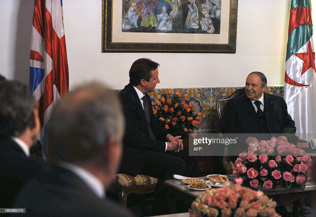Algeria's President Abdelaziz Bouteflika (R) meets with British Prime Minister <a gi-track='captionPersonalityLinkClicked' href=/galleries/search?phrase=David+Cameron+-+Politician&family=editorial&specificpeople=227076 ng-click='$event.stopPropagation()'>David Cameron</a> (C) in the capital Algiers on January 30, 2013. Cameron flew into Algeria in the wake of this month's hostage crisis at a gas plant deep in the Sahara in which several Britons were killed.