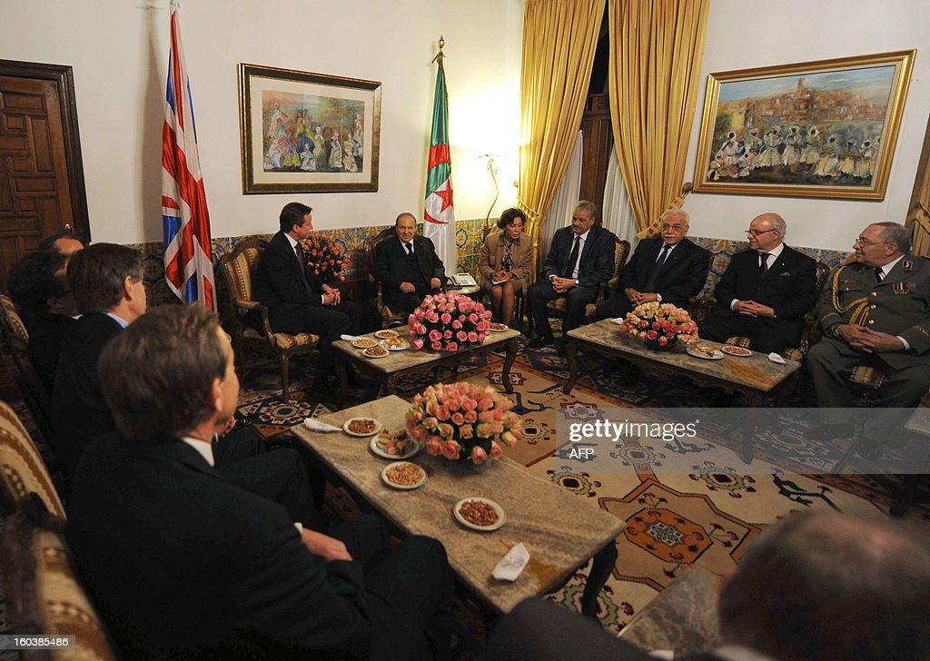 Algeria's President Abdelaziz Bouteflika (top center R) meets with British Prime Minister <a gi-track='captionPersonalityLinkClicked' href=/galleries/search?phrase=David+Cameron+-+Politician&family=editorial&specificpeople=227076 ng-click='$event.stopPropagation()'>David Cameron</a> (top center L) in the capital Algiers on January 30, 2013. Cameron flew into Algeria in the wake of this month's hostage crisis at a gas plant deep in the Sahara in which several Britons were killed.