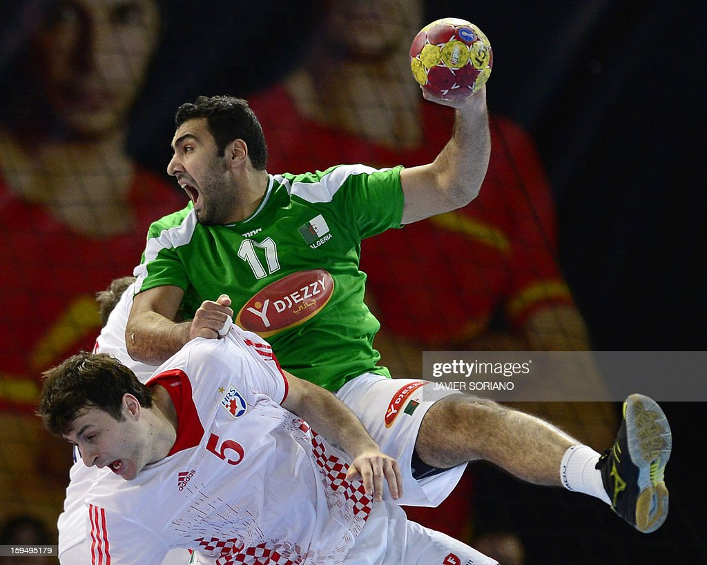 Algeria's right back Abderrahim Berriah (top) vies with Croatia's centre back Domagoj Duvnjak during the 23rd Men's Handball World Championships preliminary round Group D match Algeria vs Croatia at the Caja Magica in Madrid on January 14, 2013. Croatia won 30-20.