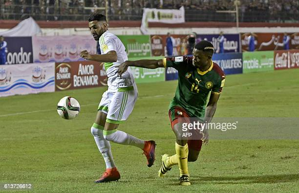 Algeria's Riyad Mahrez controls the ball as Cameroon's Aurelien Chedjou defends during the FIFA World Cup 2018 qualifying football match between...