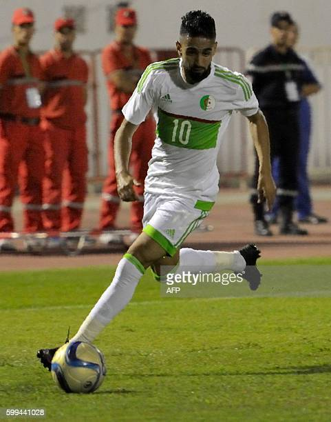 Algeria's Ryad Boudebouz runs with the ball during the 2017 African Cup of Nations qualifying football match Algeria versus Lesotho on September 4...