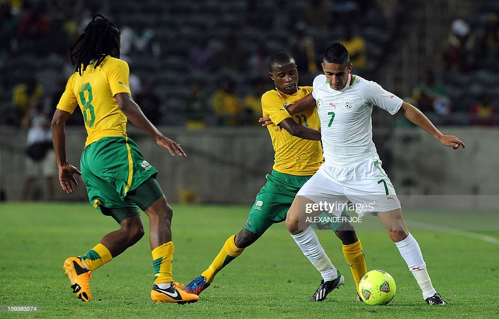 Algeria's Ryad Halliche (R) vies with South Africa's Thabo Matlaba (C) and Siphiwe Tshabalala during a friendly football match between South Africa's Bafana Bafana and Algeria in Soweto on January 12 , 2013, ahead of the 2013 African Cup of Nations that will take place in South Africa from January 19 to February 10.