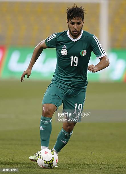Algeria's Saphir Taider dribbles the ball during their friendly football game against Oman on March 30 2015 at the Qatar Club Stadium in Doha as part...