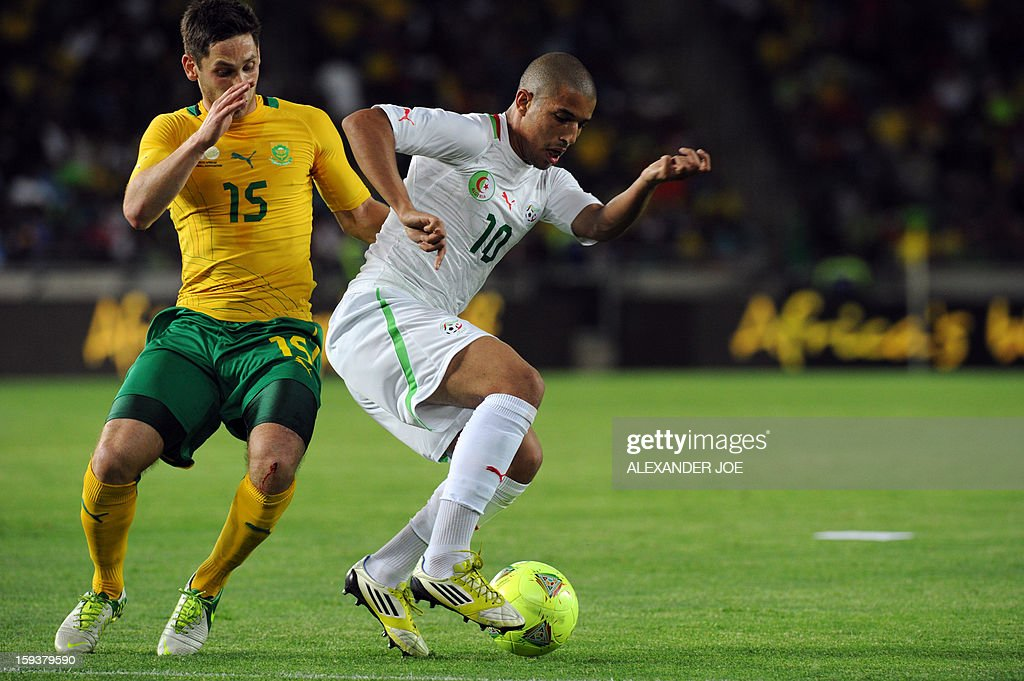 Algeria's Sofiane Feghouli (R) vies for the ball with South Africa's Dean Furman during a friendly football match between South Africa's Bafana Bafana and Algeria in Soweto on January 12 , 2013, ahead of the 2013 African Cup of Nations that will take place in South Africa from January 19 to February 10.