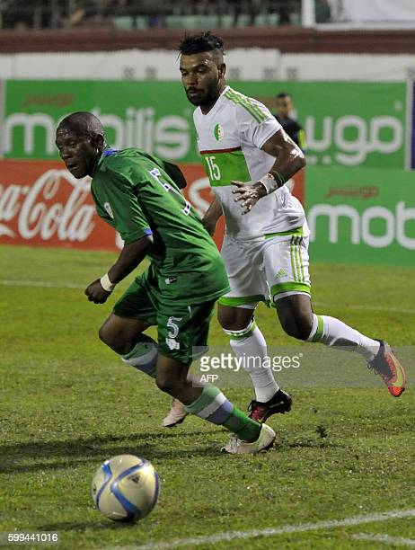Algeria's Soudani ElArbi Hillel fights for the ball with Lesotho's Mafa Moremoholo during the 2017 African Cup of Nations qualifying football match...