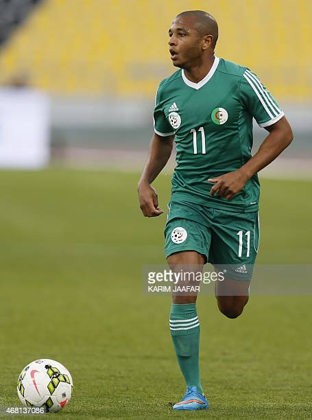 Algeria's Yacine Brahimi dribbles the ball during their friendly football game against Oman on March 30 2015 at the Qatar Club Stadium in Doha as...