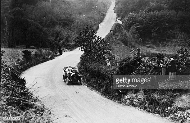Algernon Lee Guinness of Ireland drives the Darracq 18hp Veight through the Kirkmichael Dip during the III Isle of Man Tourist Trophy race on 29 May...