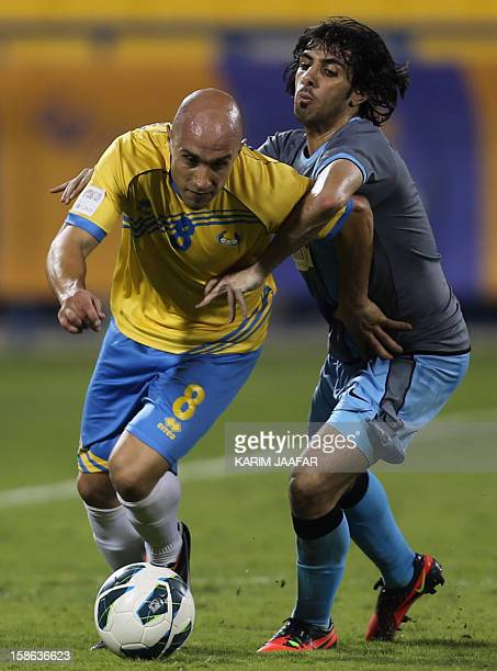 AlGharafa's Australian player Mark Bresciano dribbles past alWakrah's Khalid Muftah during their Qatar Stars football League match in Doha on...