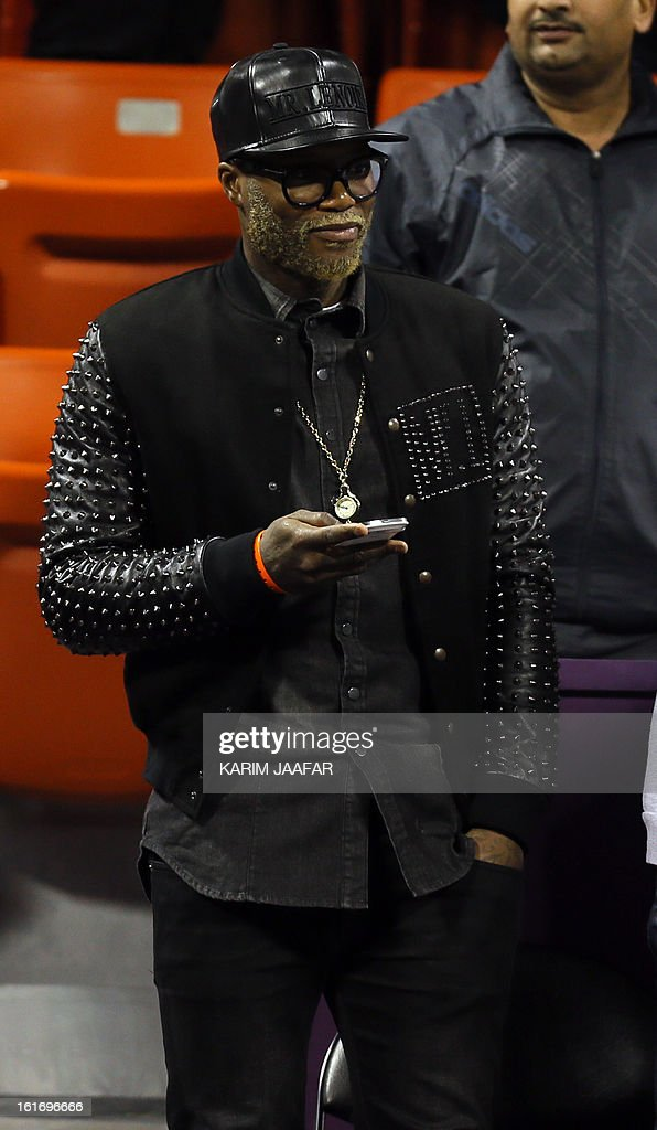 Al-Gharafa's French striker Djibril Cisse attends the tennis match between Poland's Urszula Radwanska and Serena Williams of the US in WTA Qatar Open on February 14, 2013 in the Qatari capital Doha. Williams won the match 6-0, 6-3.