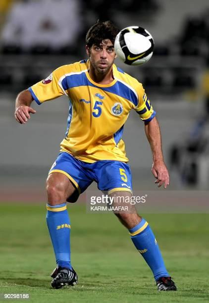AlGharrafa's Brazilian midfielder Juninho eyes the ball during his team's Sheikh Jassem Cup semifinal football match against Umm Salal in Doha late...