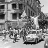 Algiers after the publication of the referendum results in favor of Algeria's selfdetermination inhabitants of the city perched on a car acclaim the...