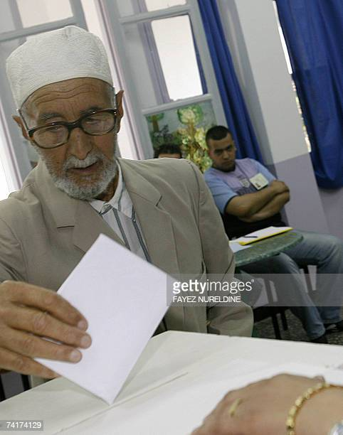 A Algerian man casts his ballot in the parliamentary elections in Algiers City 17 May 2007 Polls opened today to elect a new parliament in Algeria...