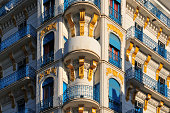 Algiers, Algeria: elegant French colonial building on Avenue Pasteur / Boulevard Khemisti - white and blue with yellow ornaments - photo by M.Torres