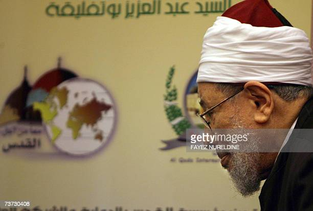 Qatar's Egyptionborn cleric Sheikh Yusuf alQaradawi walks on his way to hold a press conference on the eve of the fifth International AlQuds...