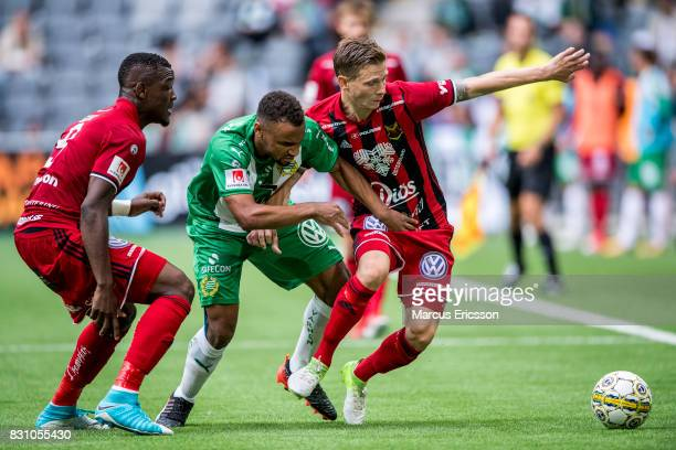 Alhaji Gero Johan Bertilsson of Ostersunds FK and SergeJunior Martinsson Ngouali of Hammarby IF during the Allsvenskan match between Hammarby IF and...