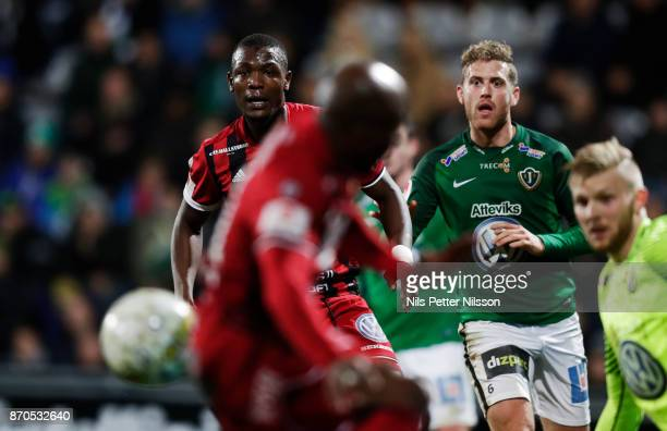 Alhaji Gero of Ostersunds FK and Stefan Karlsson of Jonkopings Sodra looks at the ball during the Allsvenskan match between Jonkopings Sodra IF and...