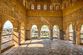 Archways in Palacio de Generalife at Alhambra di Granada,  Andalusia, Spain. This site is known as one of the most beautiful in the world and is a Unesco heritage.