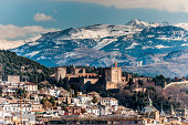 Winter view of famous Alhambra in front of Sierra Nevada, Spain.