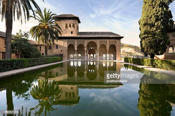 Alhambra Palace with perfect reflection in Granada, Spain